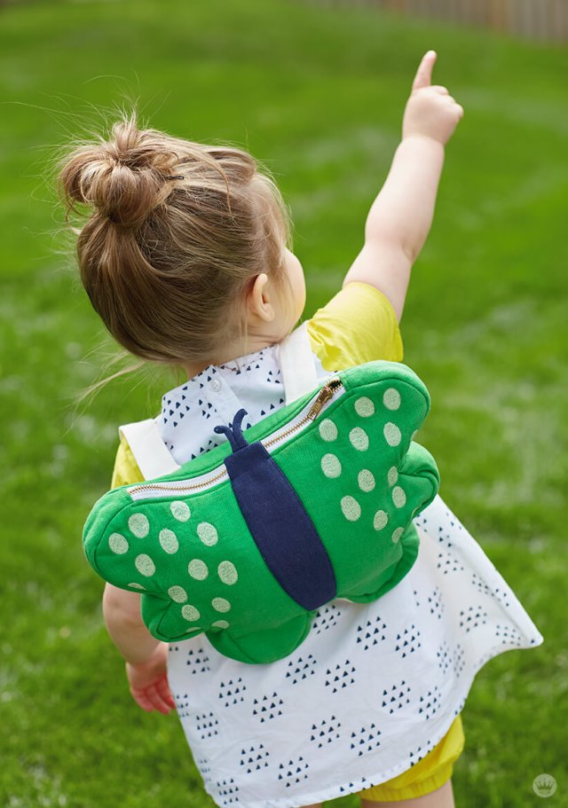Girl wearing Hallmark Baby Butterfly Backpack