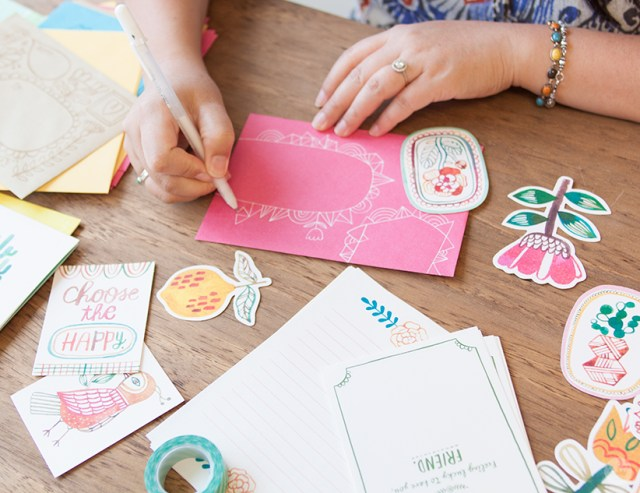 Decorating an envelope for National Card and Letter Writing Month