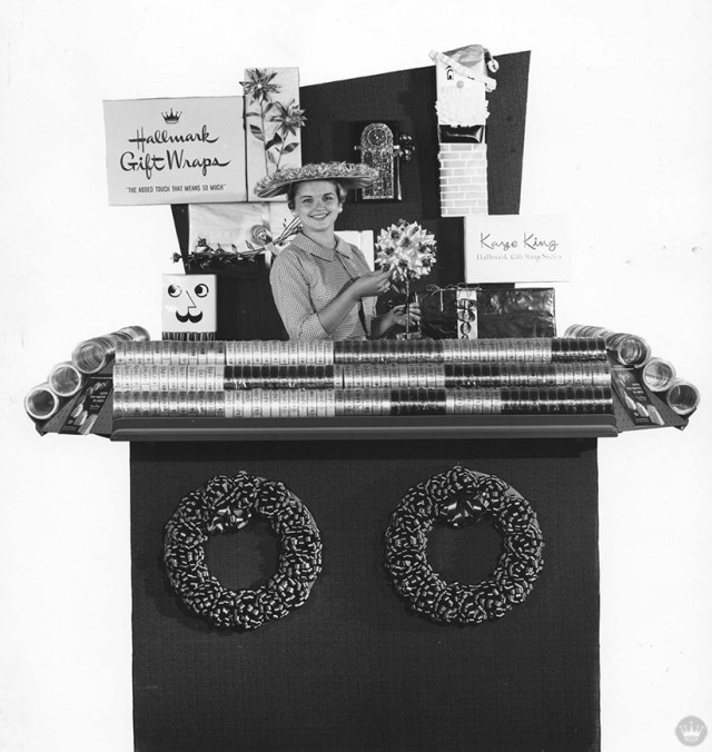 """From our gift wrap history: Stylist """"Kaye King"""" poses with her pop-up Hallmark Gift Wraps booth, c. 1956"""