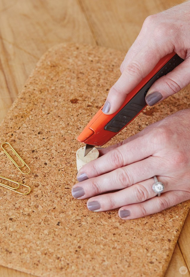 Cutting a cork for Candlestick Christmas card holders