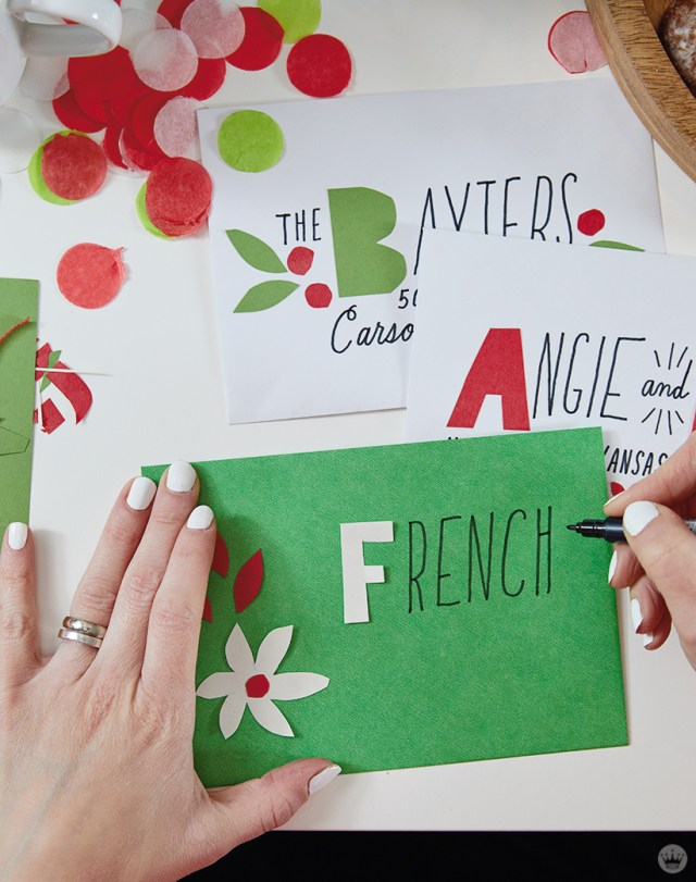 Decorating an envelope at a Christmas card party