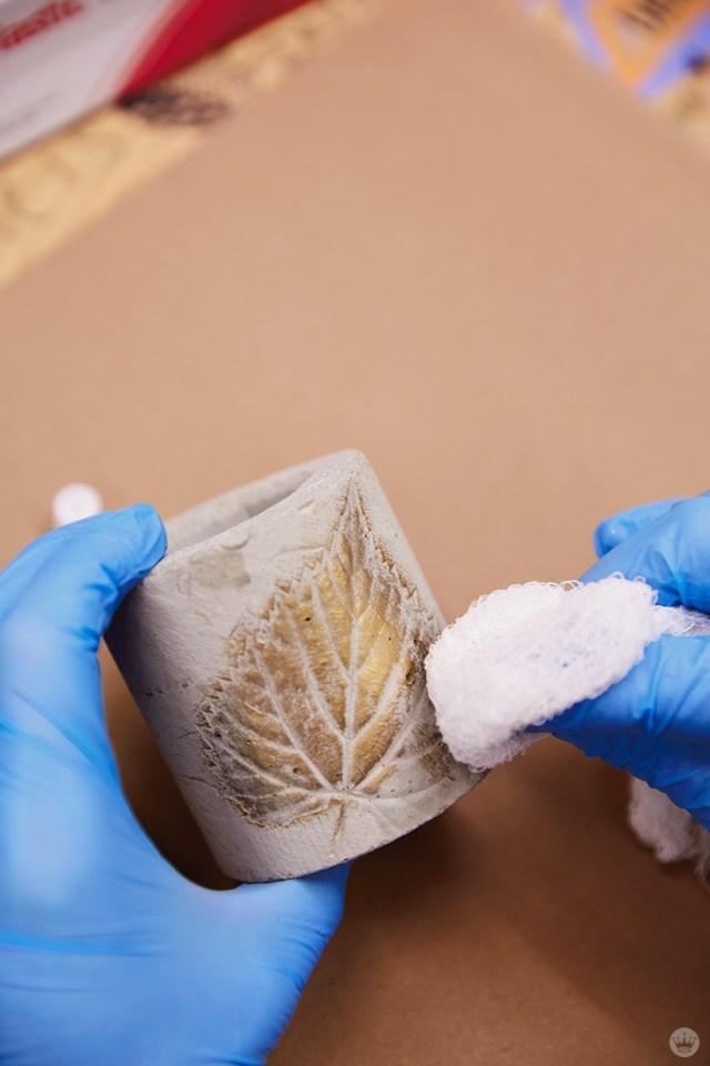 Applying metallic wax to a concrete vase