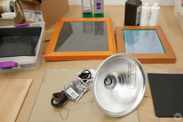 Cyanotype print making supplies: trays, frames, chemicals, lamp