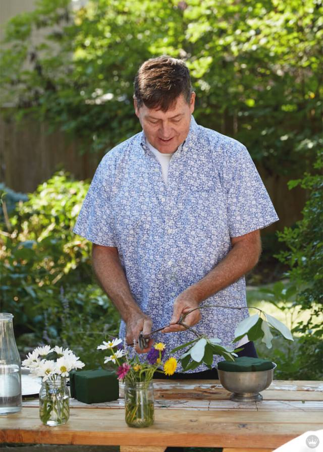 Hallmark Photo Stylist Andy N. arranging flowers