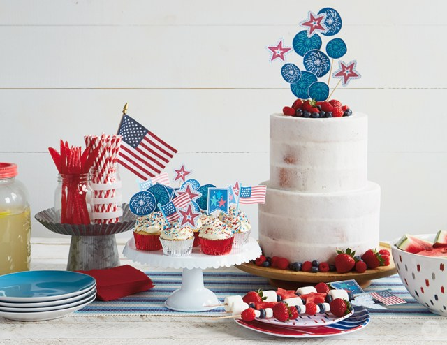 July 4th cupcakes, cake, and fruit skewers decorated with free printable toppers.