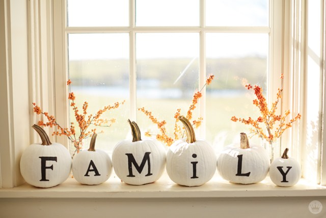 Hand-lettered white pumpkins on window sill: FAMILY