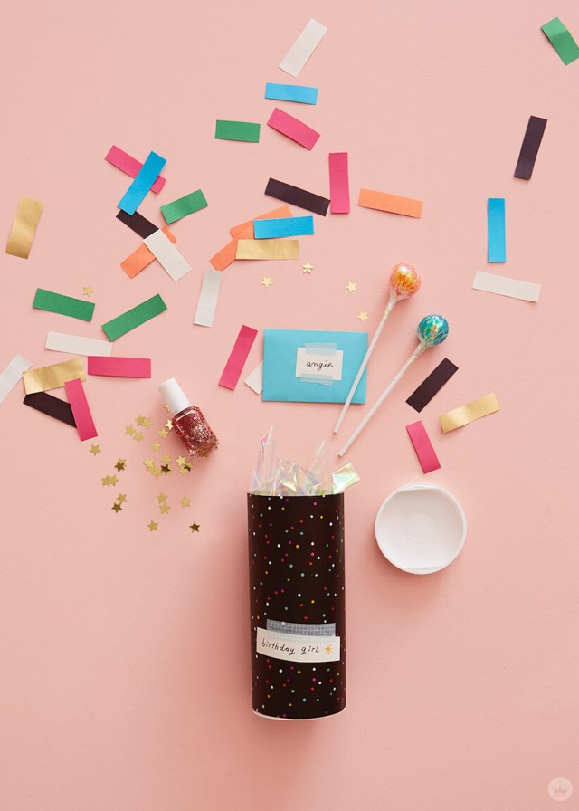 Easy mail art: Mailing tube covered in wrapping paper full of confetti, sprinkles, lollypops, nail polish, and a Just Because card from Hallmark.