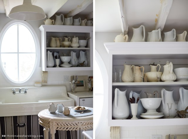 Tips for displaying art: White English ironstone pitchers and bowls in an open-face kitchen cabinet