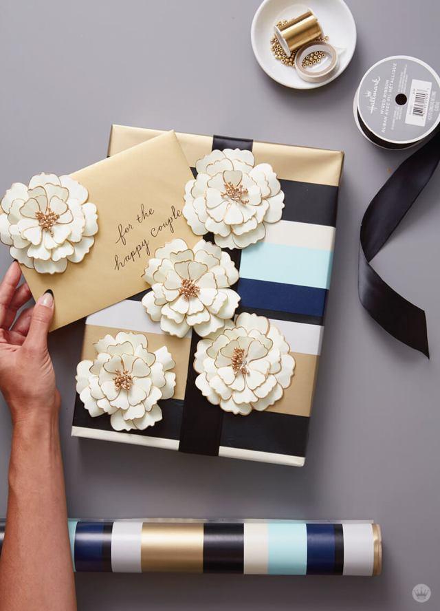 Wrap a wedding present with multiple paper flowers as design element | thinkmakeshareblog.com