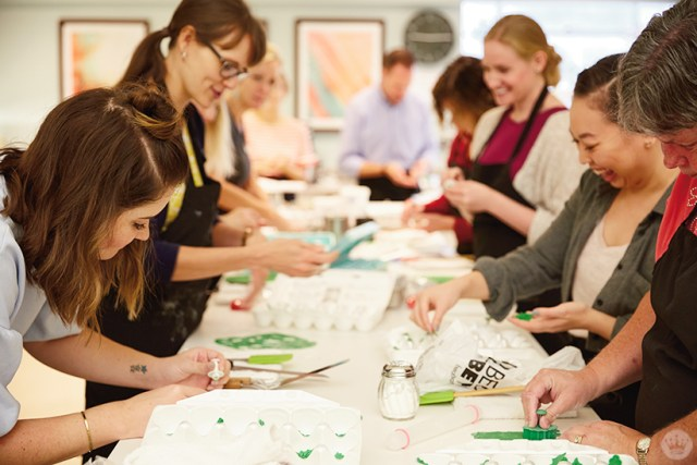 Hallmark creative team members learning holiday cake decorating ideas