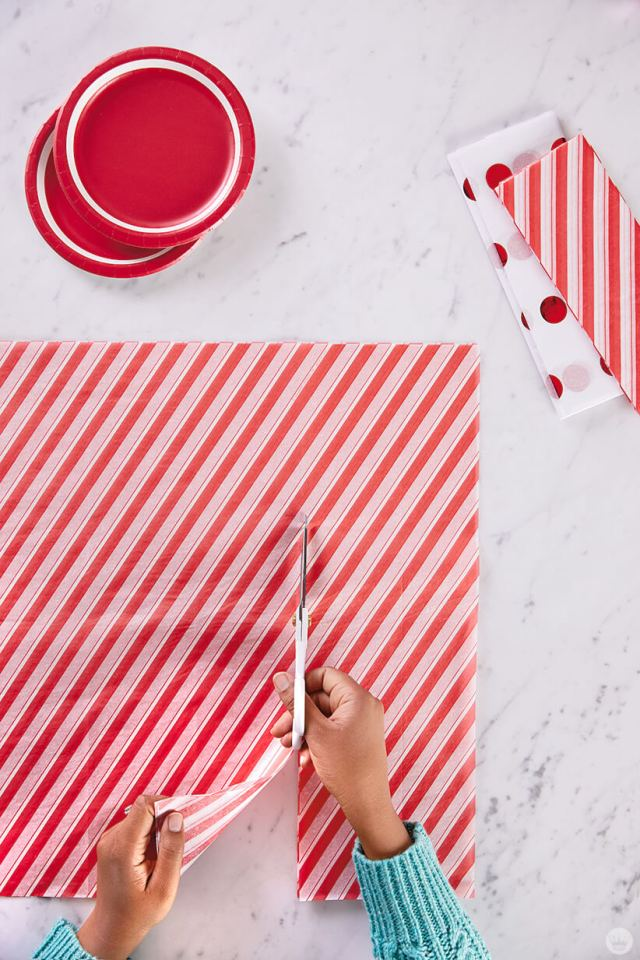 Cutting red and white striped gift wrap | thinkmakeshareblog.com