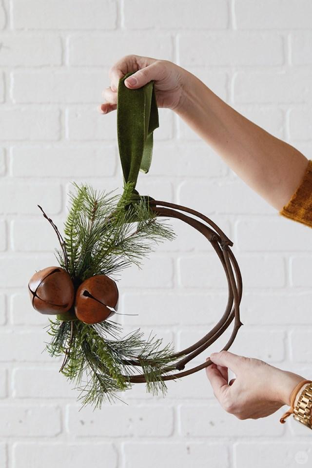 Modern Christmas wreath ideas: Asymmetrical wreath with antiqued bells