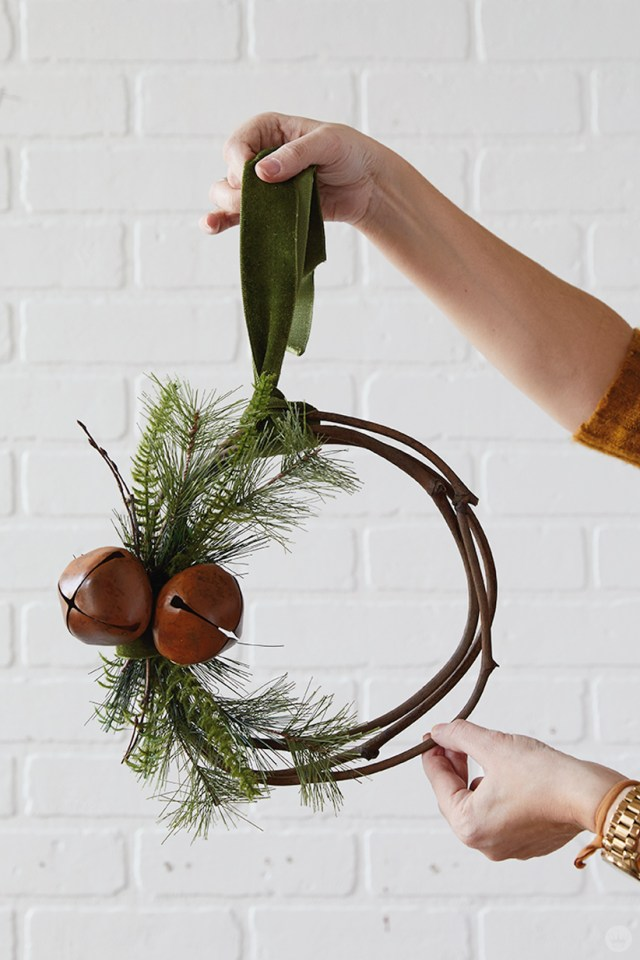 Modern Christmas wreath ideas: Asymmetrical wreath with antiqued bells