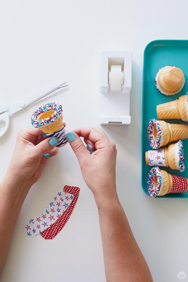 Taping wrapper around cone to make Patriotic Ice Cream Cone