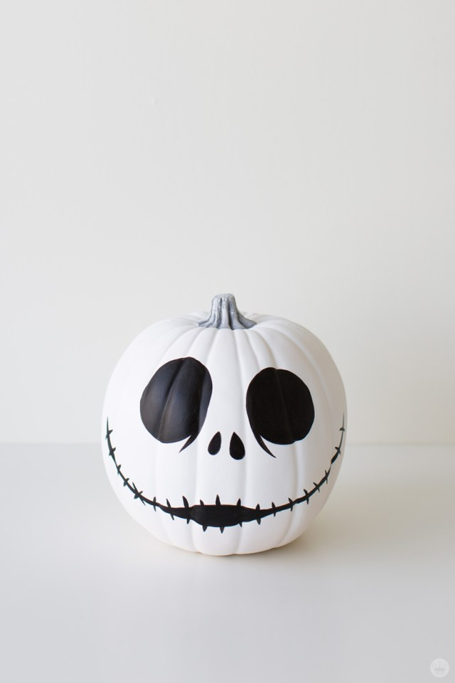 White pumpkin decorated with black paint to resemble Jack Skellington from The Nightmare Before Christmas
