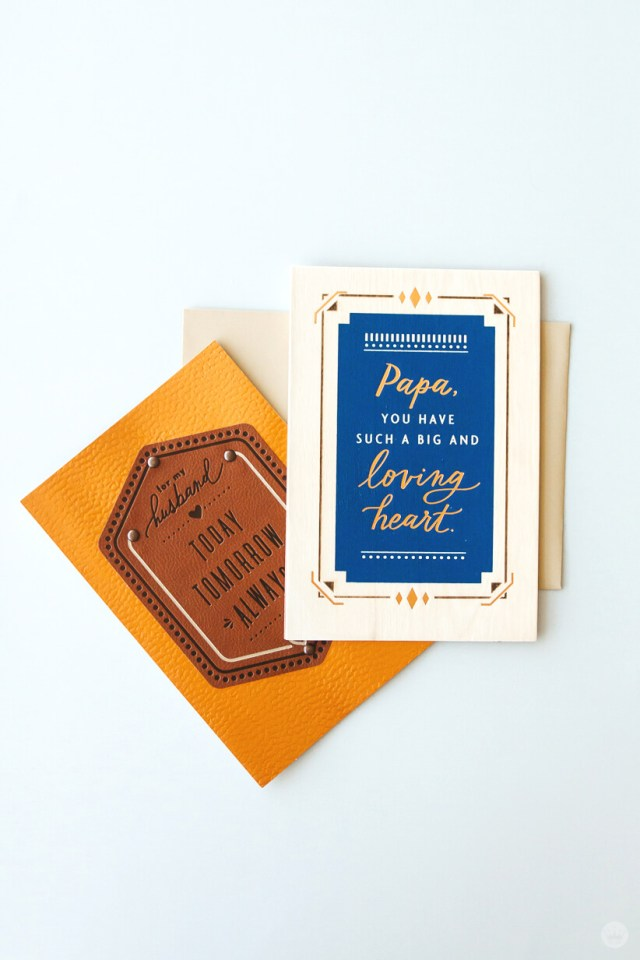 Two cards from Hallmark's Man Made Father's Day card collection featuring fabric, leather, and copper