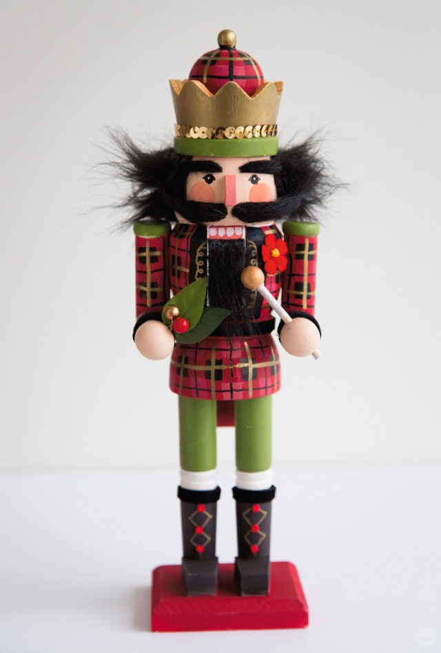 Finished hand painted nutcracker with plaid uniform