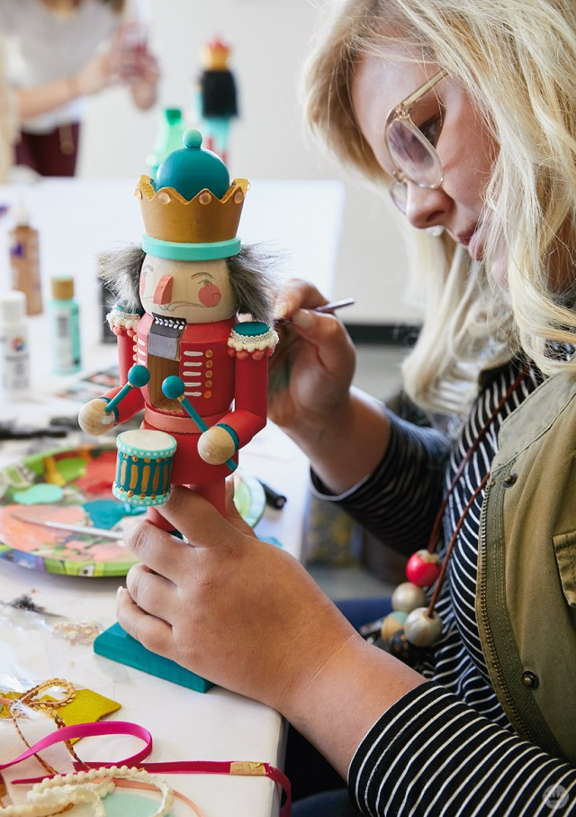 Hallmark artist in a paint your own nutcracker workshop