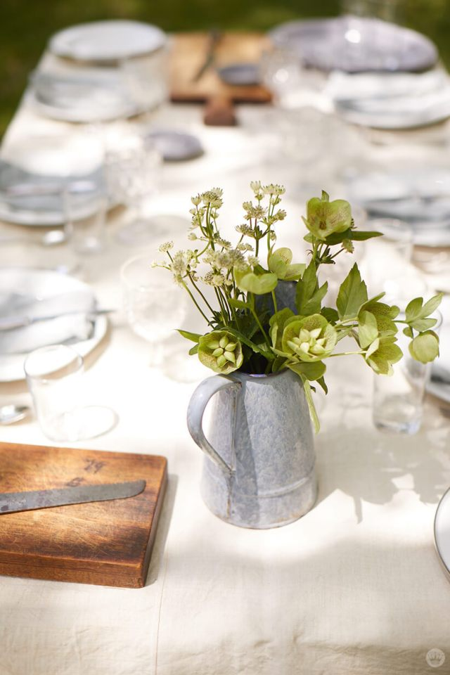 floral greenery in a water pitcher on a table | thinkmakeshareblog.com