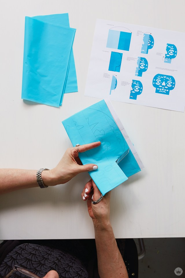 DIY Papel Picado: Cutting along template lines to create skull design