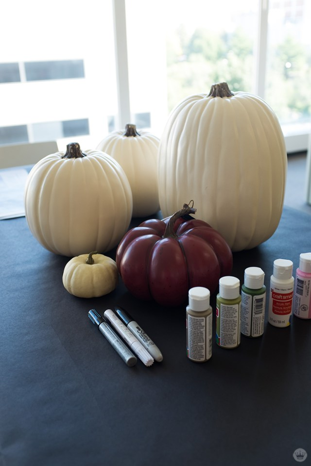 Supplies: Red and white pumpkins, permanent markers and metallic paint pens, and a limited paint palette.