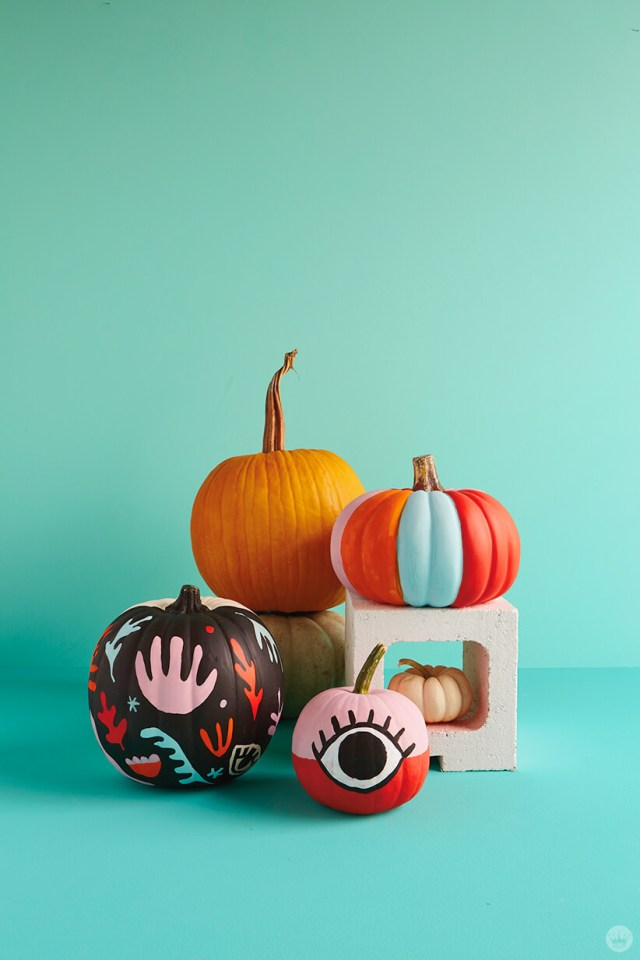 Display of natural and painted pumpkins