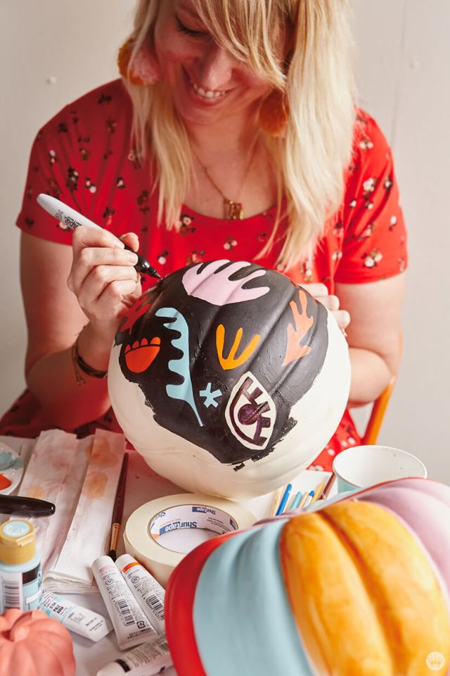 Kristin paints a Matisse-inspired design on a white pumpkin