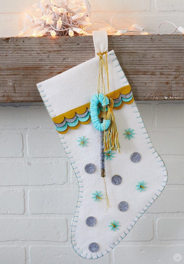 DIY Christmas stocking with appliqués, tassel, and yarn-wrapped C