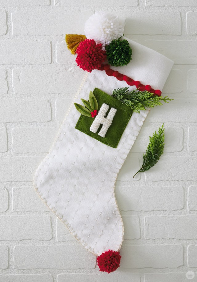 DIY Christmas stocking with wrapped letter, pocket, and pom poms