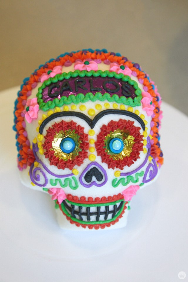 A sugar skull decorated by a Hallmark Artist