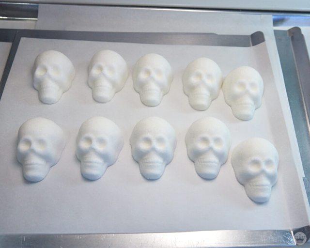 Dry sugar skulls on a sheet pan