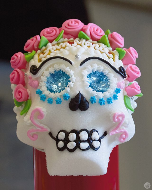 A sugar skull decorated by a Hallmark Artist