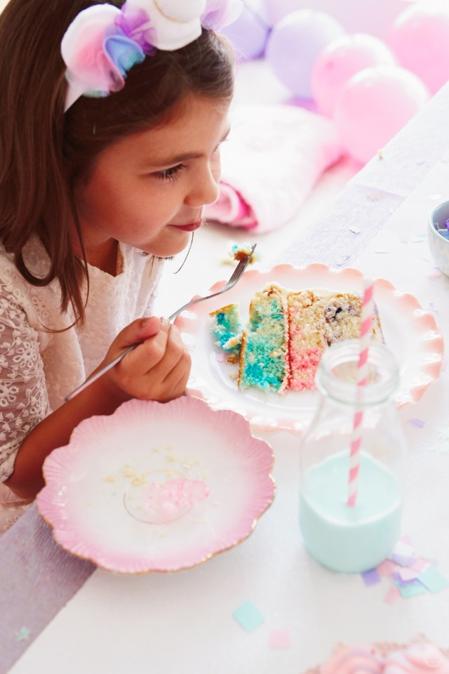 Girl eating a slice of birthday cake
