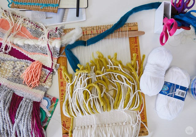Weaving workshop: fiber art pieces in progress with yarn and other colorful materials