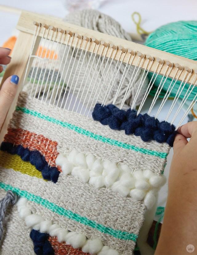 Weaving workshop: hallmark artist weaves colorful fiber art piece on small loom