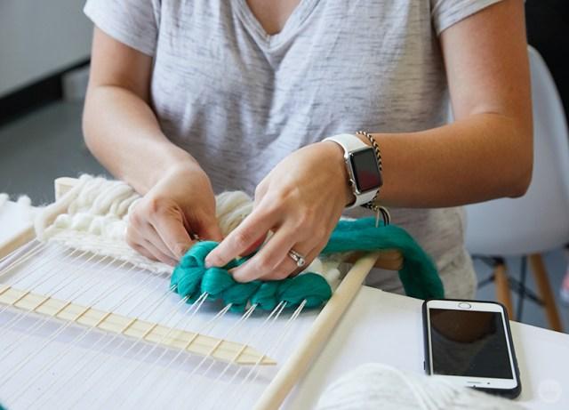 Weaving workshop: hallmark artists uses roving on fiber art piece