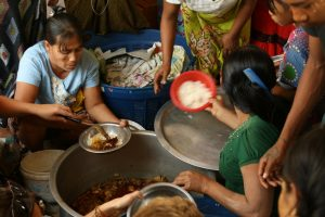 An image of us helping to serve food to the village.