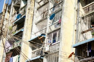 An image of the apartment building and electrical wires in central Yangon on the way to the ferry terminal to Dala.