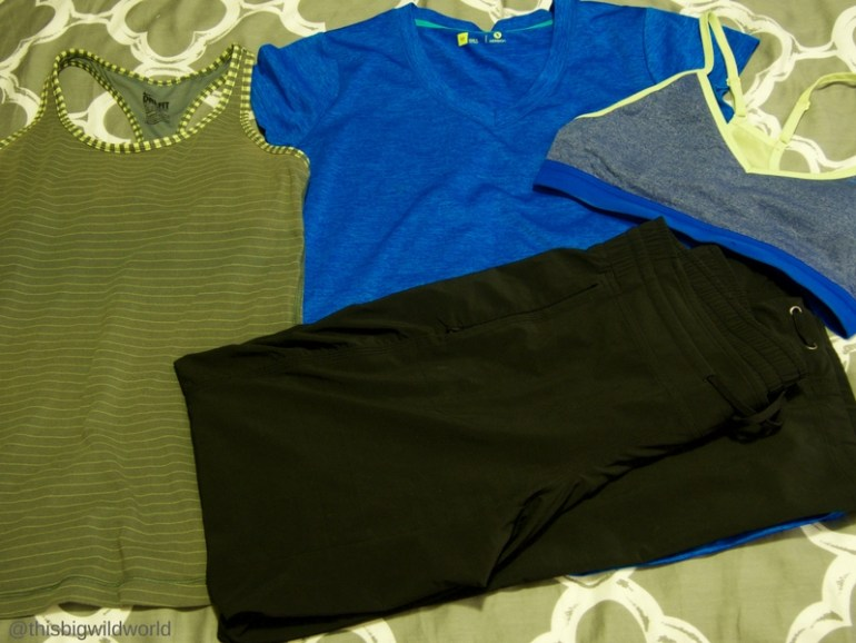 Image of clothing packed for the Inca Trail hike in Peru, including a tank top, a lightweight v-neck t-shirt, and breathable pants.
