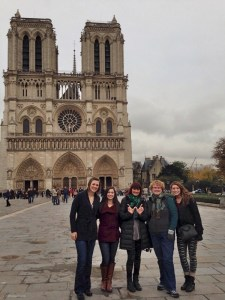 Image of me and four cousins in front of Notre Dame Cathedral in Paris.