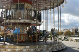 Image of carousel near the Eiffel Tower in Paris.