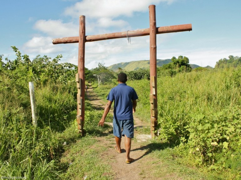 Image of my guide walking barefoot during a tour of a village on Nacula Island in Fiji.