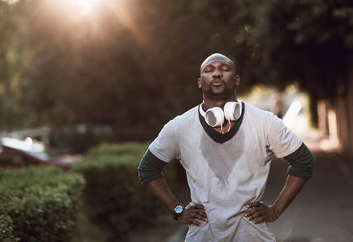 sweaty man jogging