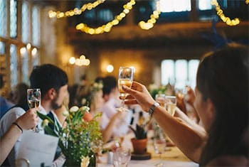 People raising glass with wine