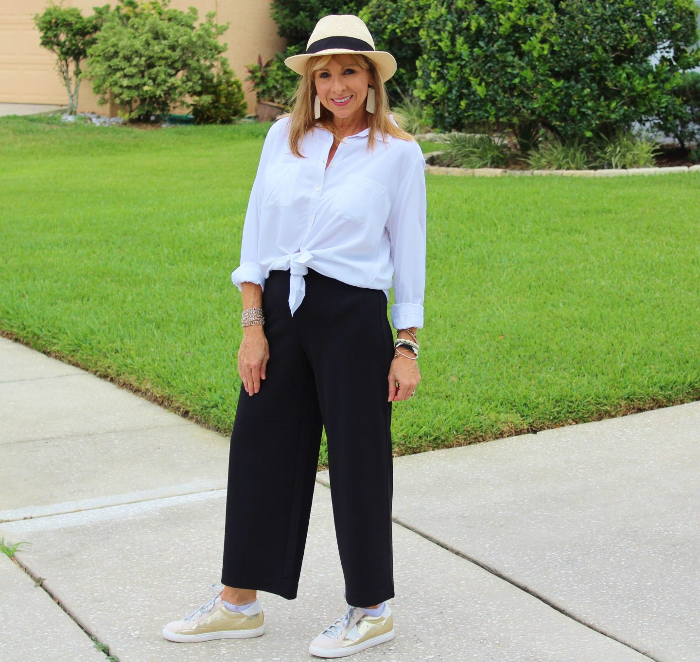 Black Wide Leg Pants + White Button Up Shirt + Hat