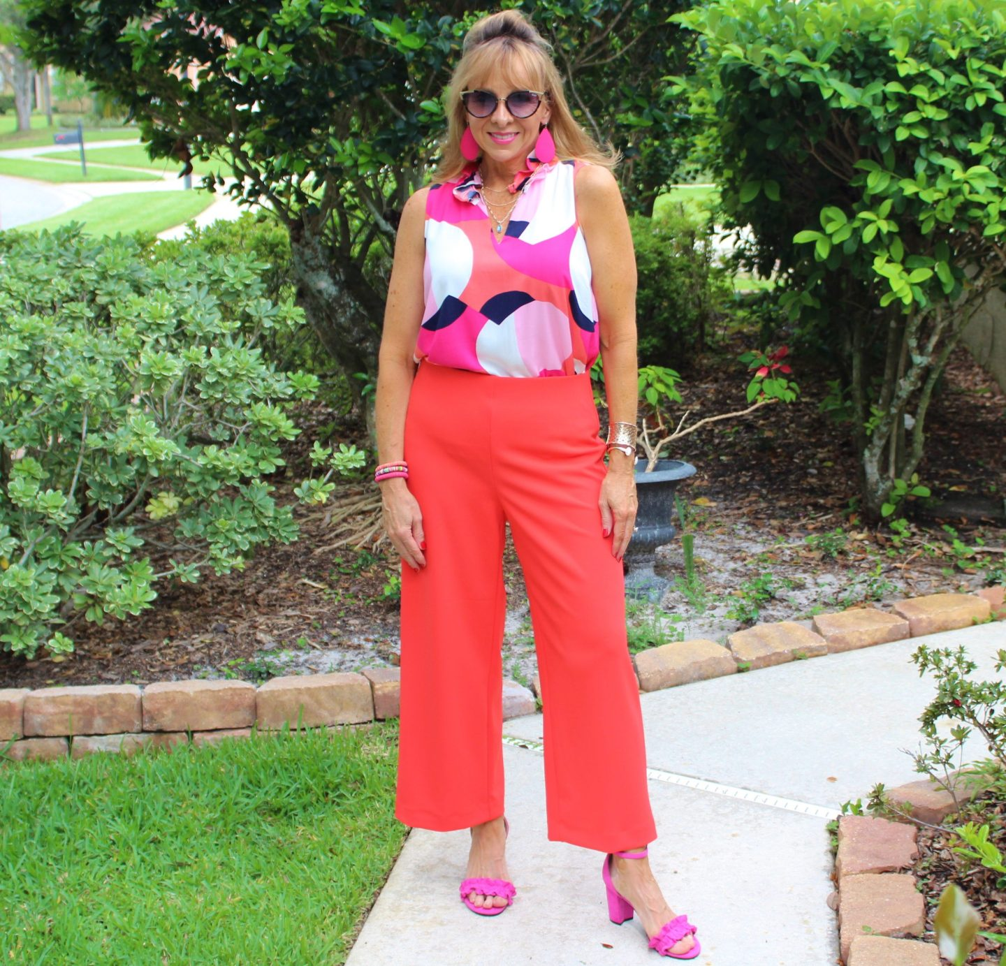 Printed Sleeveless Top + Orange Pants + Hot Pink Heels