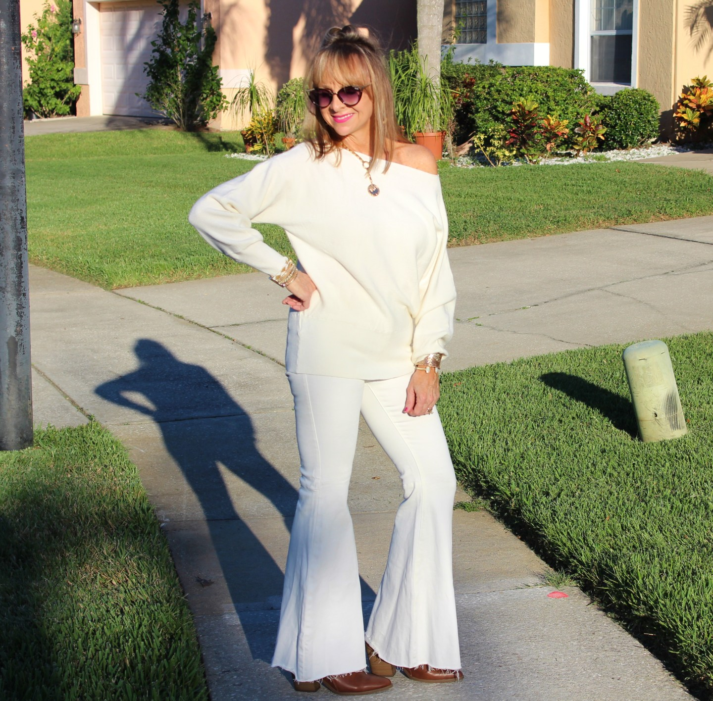 OTS Cream sweater + Flare leg pants
