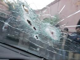 The tight pattern of bullet holes in the windshield shows the precision of Davis's shots at his victims.
