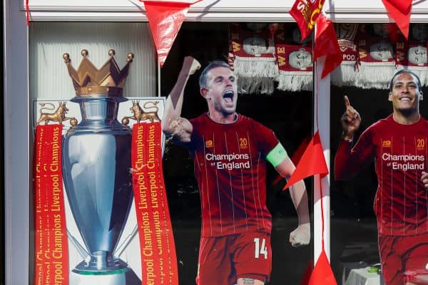 """LIVERPOOL, ENGLAND - Wednesday, June 24, 2020: A window of a shop selling """"Liverpool League Champions 2020"""" merchendise on an empty road near Liverpool FC's Anfield stadium pictured before the FA Premier League match between Liverpool FC and Crystal Palace FC at Anfield. The game was played behind closed doors due to the UK government's social distancing laws during the Coronavirus COVID-19 Pandemic. (Pic by David Rawcliffe/Propaganda)"""
