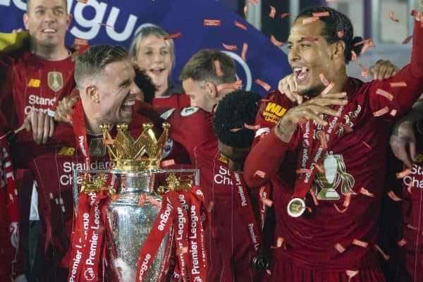 LIVERPOOL, ENGLAND - Wednesday, July 22, 2020: Liverpool's captain Jordan Henderson (C) celebrate with Virgil van Dijk and the Premier League trophy as the Reds are crowned Champions after the FA Premier League match between Liverpool FC and Chelsea FC at Anfield. The game was played behind closed doors due to the UK government's social distancing laws during the Coronavirus COVID-19 Pandemic. (Pic by David Rawcliffe/Propaganda)